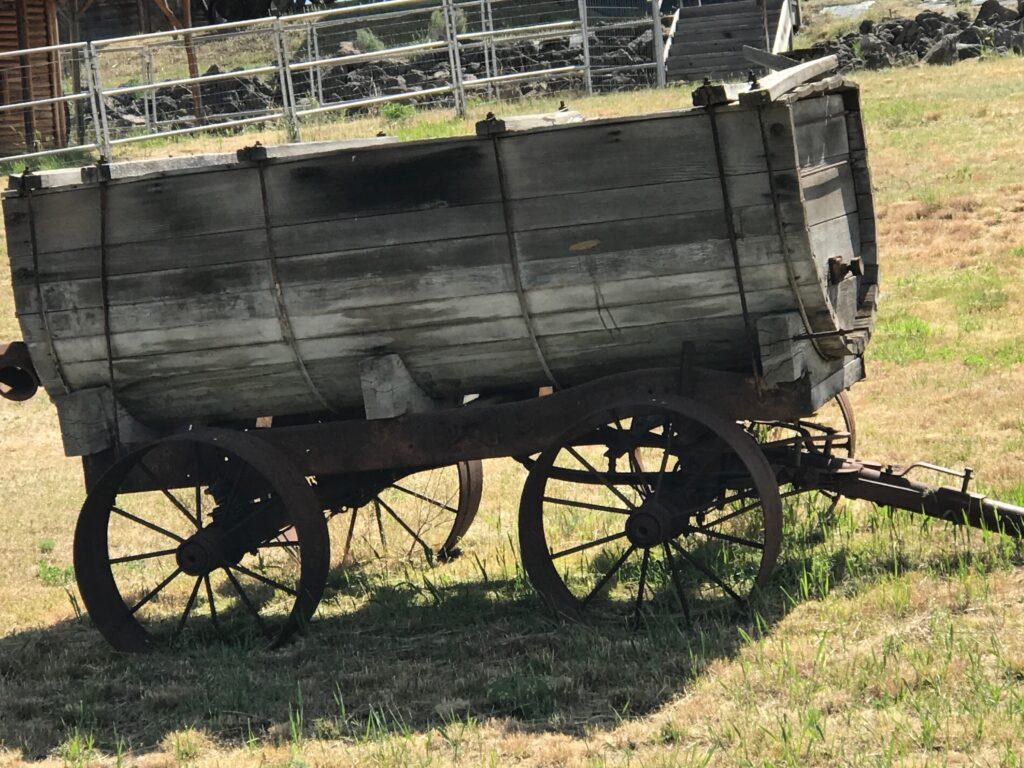 Along the Oregon Trail enroute to buy new a RV - antique wagon