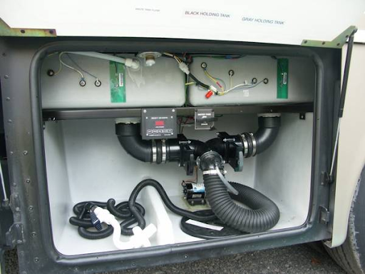 A typical wet-bay arrangement for dumping tanks will be high on the new RV owner's list of things to learn